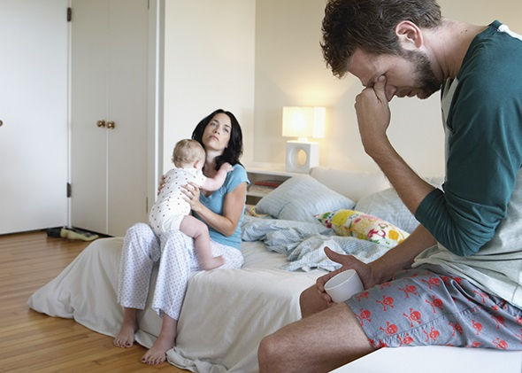 Exhausted Parents With Baby